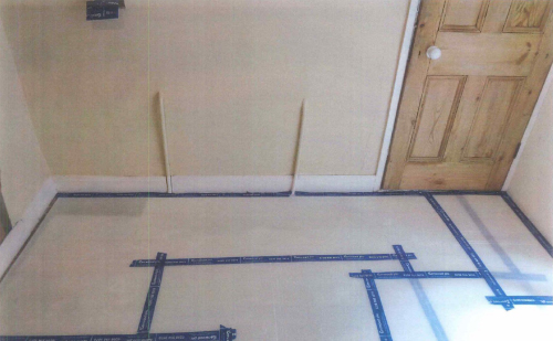 Preparation for treatment- floor protection laid, radiator removed and socket isolated