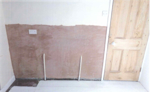 Floor protection laid, radiator removed and socket isolated