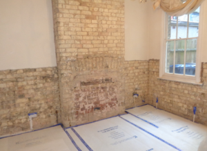 Wall plaster removed ready for injection