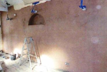 Internal walls of damp proofing in children's centre