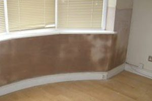 Damp Proofing wall under window after pic