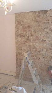 Wall plaster removed