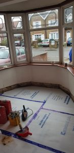 Floor protection laid and skirting boards removed ready for plaster removal